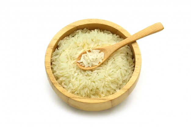 Isolated jasmine rice in a wooden bowl and spoon