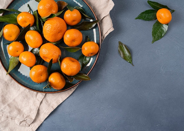 Isolated mandarin (tangerine) on black background. fresh tangerines citrus. clementine fruit with green leaf, healthy delicious organic food, christmas plant