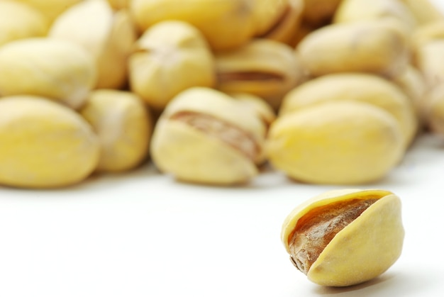 Isolated pistachios on a white background