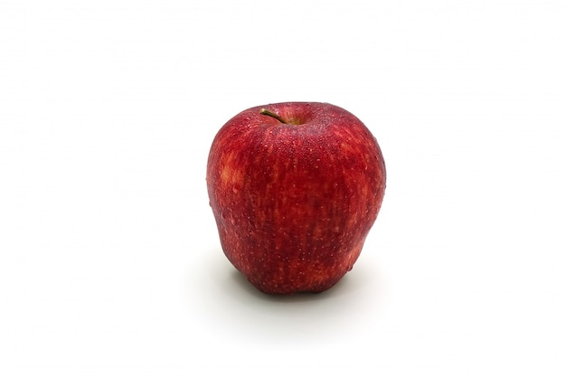 Isolated red apple sliced on white surface