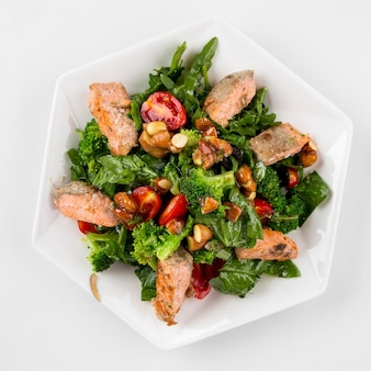 Isolated salmon salad with herbs and almonds