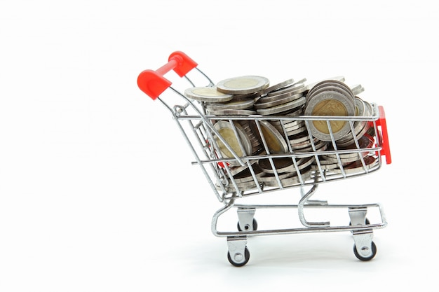 Isolated shopping cart with full wealth coins inside on white ba