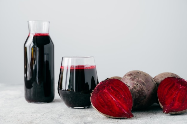 Isolated shot of fresh red beetroot juice and sliced beet.