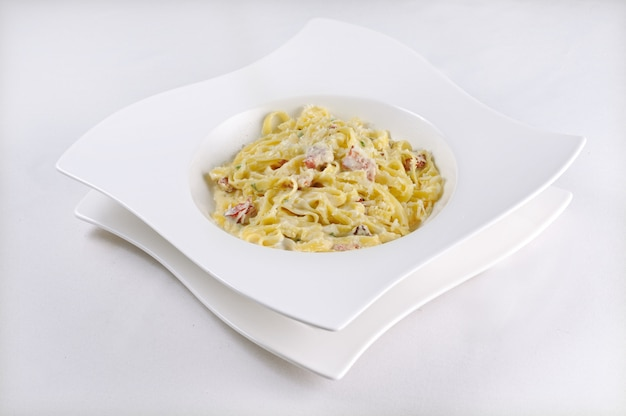 Isolated shot of pasta carbonara - perfect for a food blog or menu usage