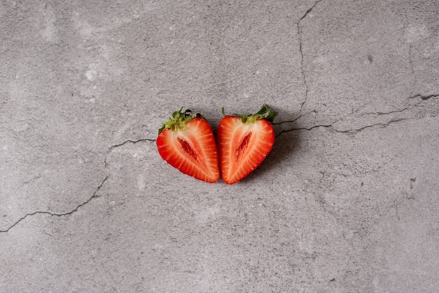 Isolated strawberries. two heart shaped strawberry fruits cut in half