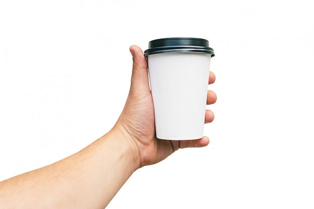 Isolated takeaway cup, for coffee, tea in a guy s hand with a black cap