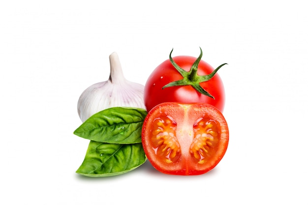 Isolated tomatoes, garlic and basil