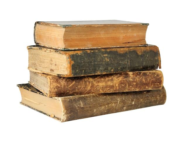 Изолированные старинные книги в стопке, изолированные на белом пространстве