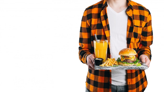 Isolated on white man is holding his lunch on a tray.