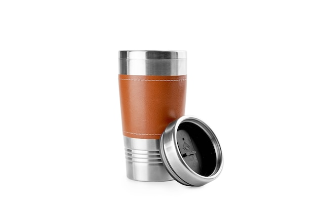 Isolated in white thermo reusable cup of stainless steel and leather. eco friendly lifestyle.