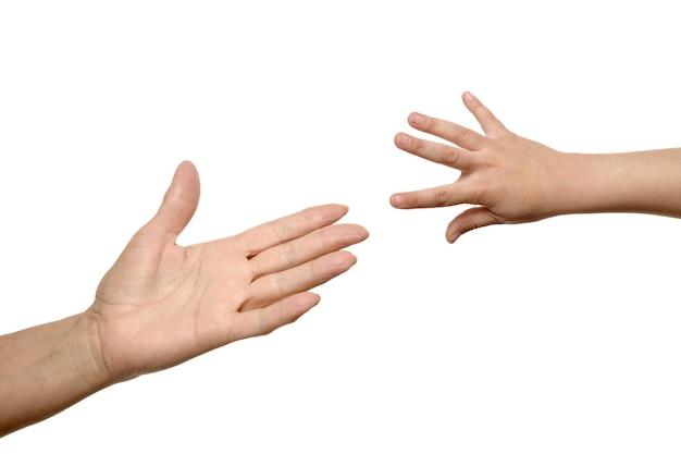 Isolated woman and child hands reach toward each other