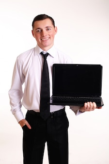 Isolated young business man with notebook