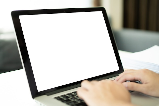 Isolation with clipping path. young businessman working in front of the laptop computer during the quarantine or self-isolation. businessman using notebook computer to work. empty notebook screen.