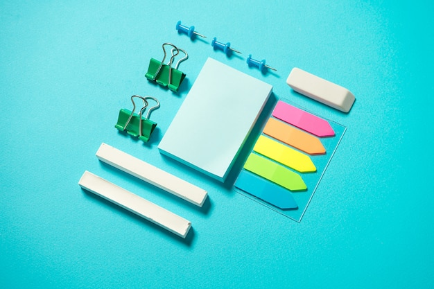 Isometric conposition with chalk, sticker, binder, eraser and pin. office and back to school cocnept. flat lay branding mock up stationery. copy space. top view. school supplies