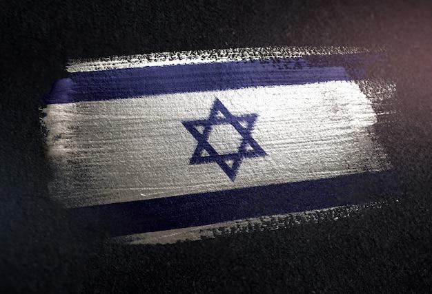 Israel flag made of metallic brush paint on grunge dark wall
