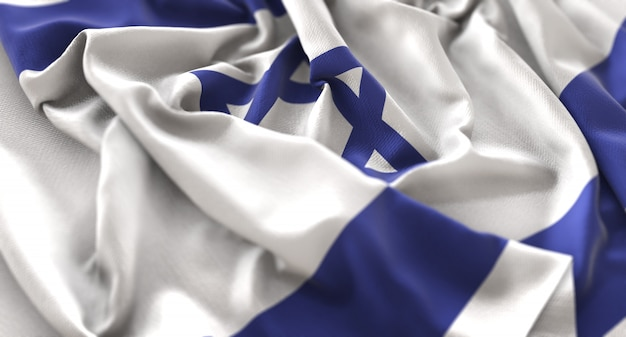 Israel flag ruffled beautifully waving macro close-up shot