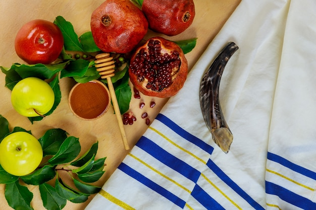 Israel talit with shofar and food for rosh hashanah. religion holiday.