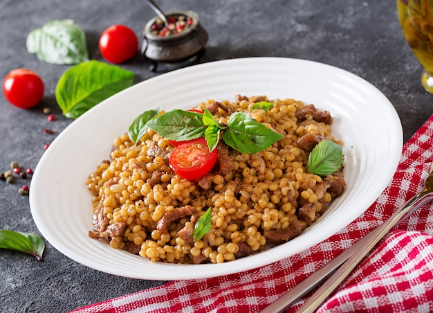 Israeli couscous with beef. tasty food. asian meal.