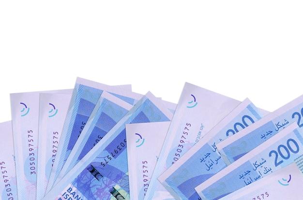 Israeli new shekels bills laying on white surface