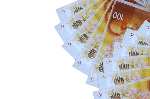 Israeli new shekels bills on a white background