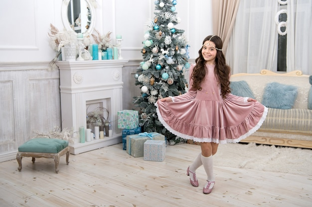 It looks a lot like christmas. christmas party girl drop curtsy. little kid with festive look. happy child celebrate christmas and new year. christmas eve. merry xmas. happy new year. holiday season.