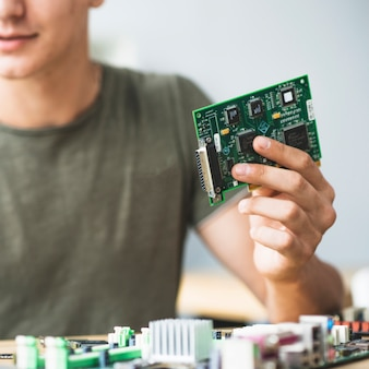 It technician holding hardware equipment
