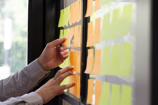 It worker tracking his tasks on kanban board.