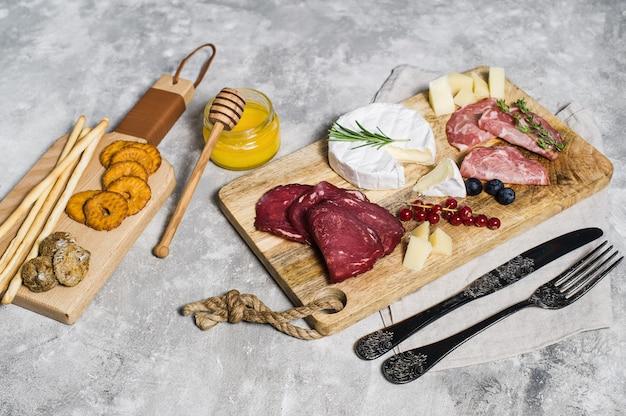 Italian antipasto with prosciutto, salami, parmesan, brie and gorgonzola cheese, honey.