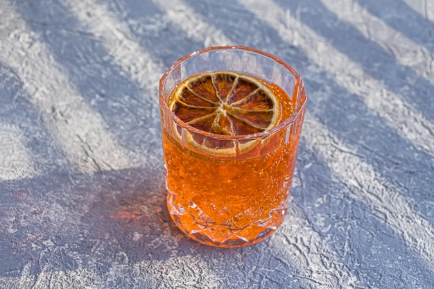 Italian aperol spritz alcohol cocktail with ice cubes