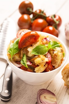 Italian appetizer salad with tomatoes, bread and bazil