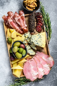 Italian appetizers or antipasto set mixed delicatessen of cheese and meat snacks