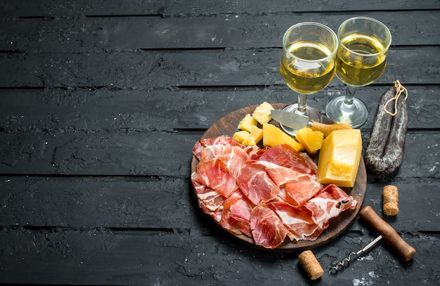Italian appetizers with white wine.