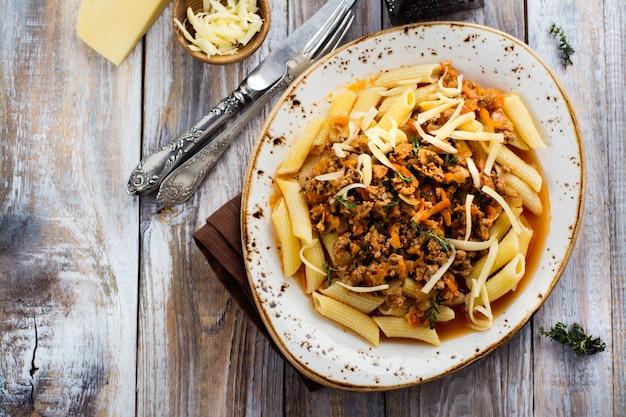 Italian bolognese pasta on wooden table