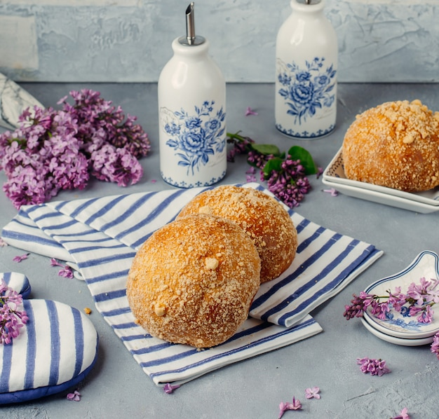 Italian bomboloni on a tissue with flowers around.