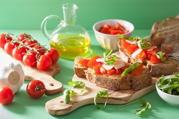 Italian bruschetta with tomatoes parmesan rucola