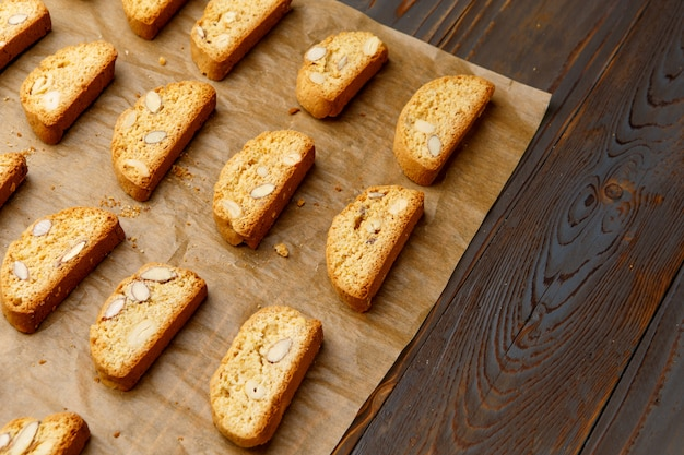 Italian cantuccini cookie with almond filling on wooden table
