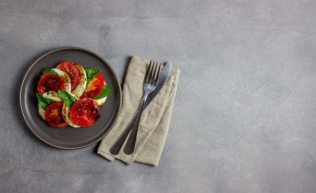 Italian caprese salad with mozzarella and tomatoes. concrete. healthy food.
