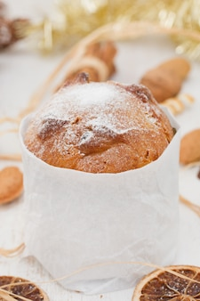 Italian christmas dessert on white wooden surface