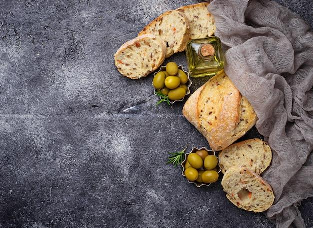 Italian ciabatta bread with olives. top view