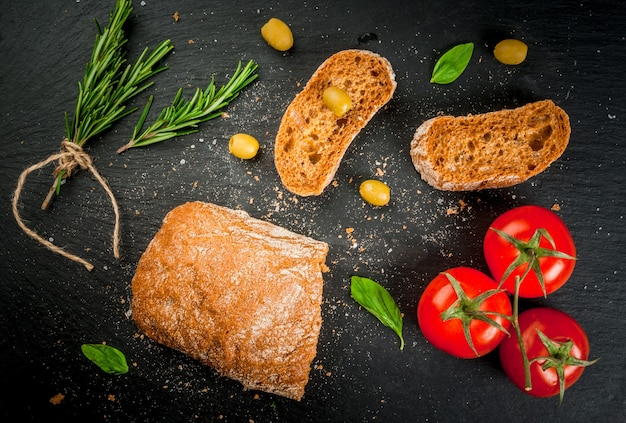 Italian ciabatta with oil, olives and greens