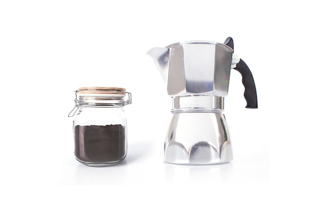 Italian coffee maker or moka pot and jar of instant coffee isolated on white background