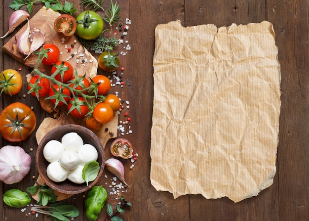 Italian cooking ingredients : mozzarella, tomatoes, garlic, herbs and other