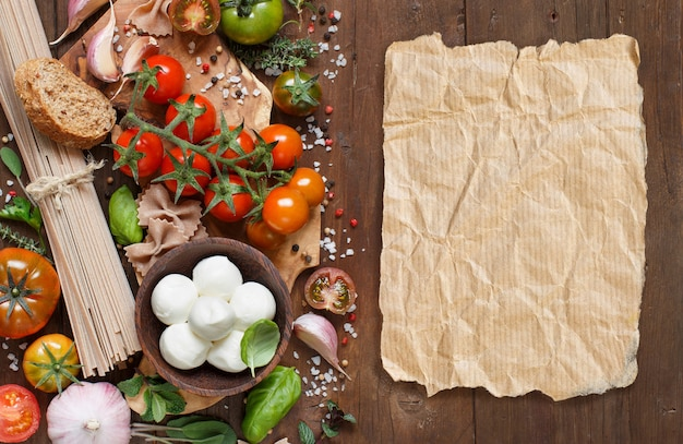 Italian cooking ingredients : mozzarella, tomatoes, garlic, herbsl and other