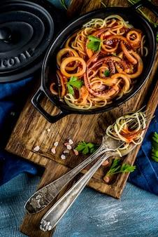 Italian cuisine, calamari fra diavolo, spaghetti pasta marinara with seafood