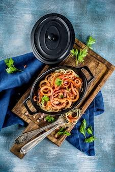 Italian cuisine, calamari fra diavolo, spaghetti pasta marinara