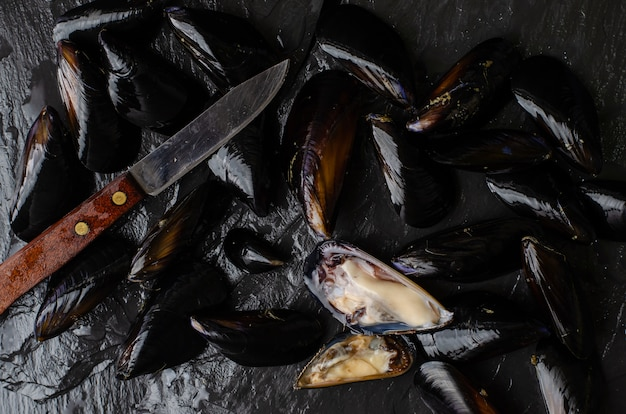 Italian cuisine concept. mussels cooking process. directly above, flat lay