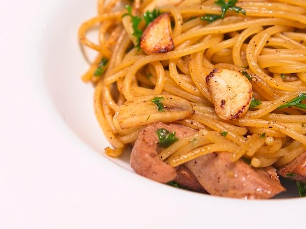 Italian cuisine, spicy spaghetti with pork sausage and garlic