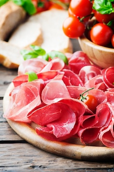 Italian delicious antipasto with ham and bresaola