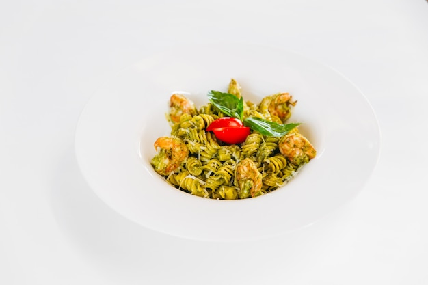 Italian dish green fusilli pasta with shrimps