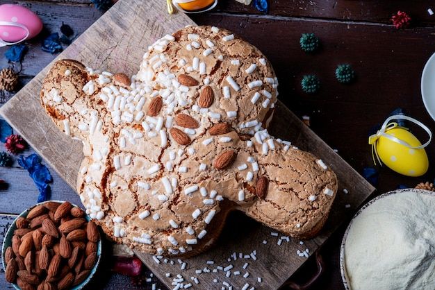 Italian easter cake dove bread on a plan board freshly baked with ingredient